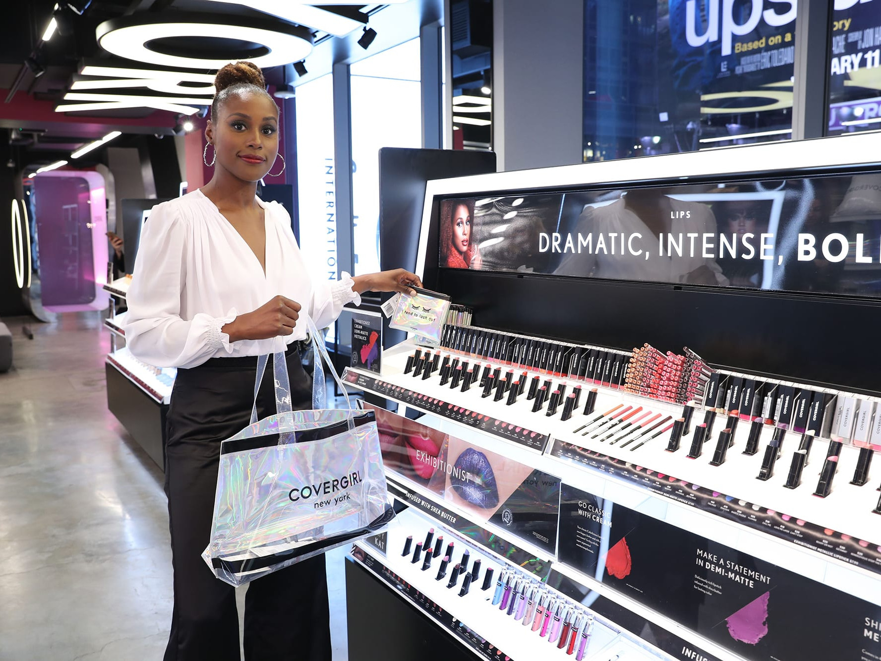 Issa Rae shopping in the Covergirl Time Square store designed by VMGROUPE